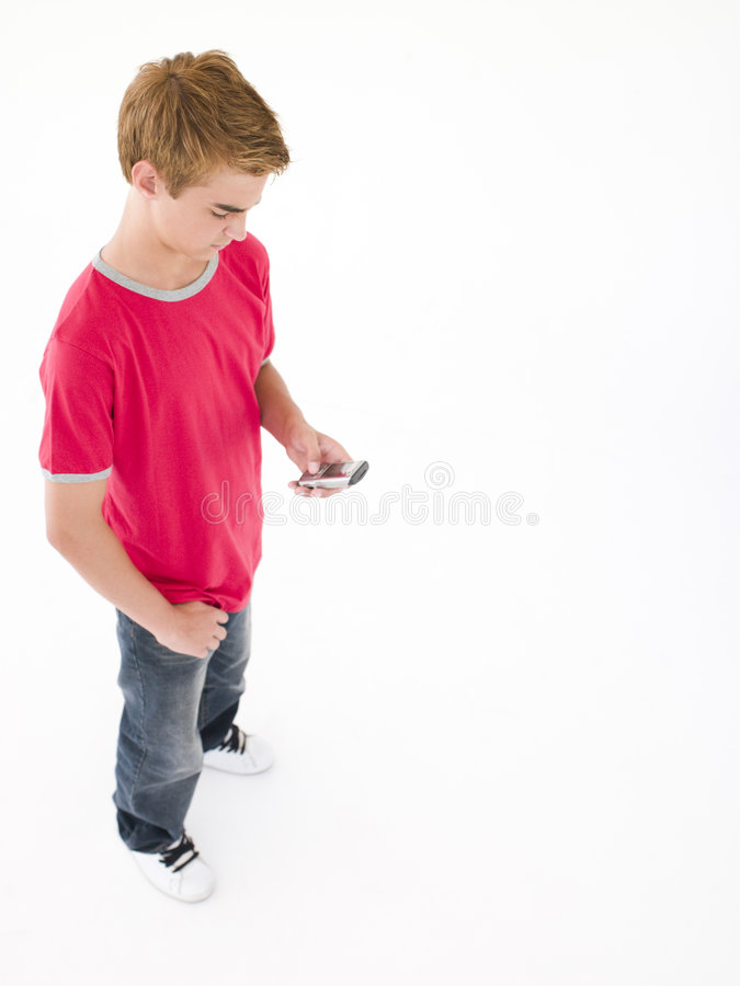 Download Young Boy Using Cellular Phone Stock Image - Image: 5945501