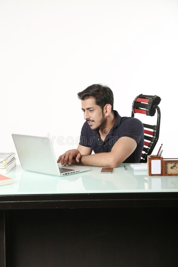 Young boy is using laptop stock image