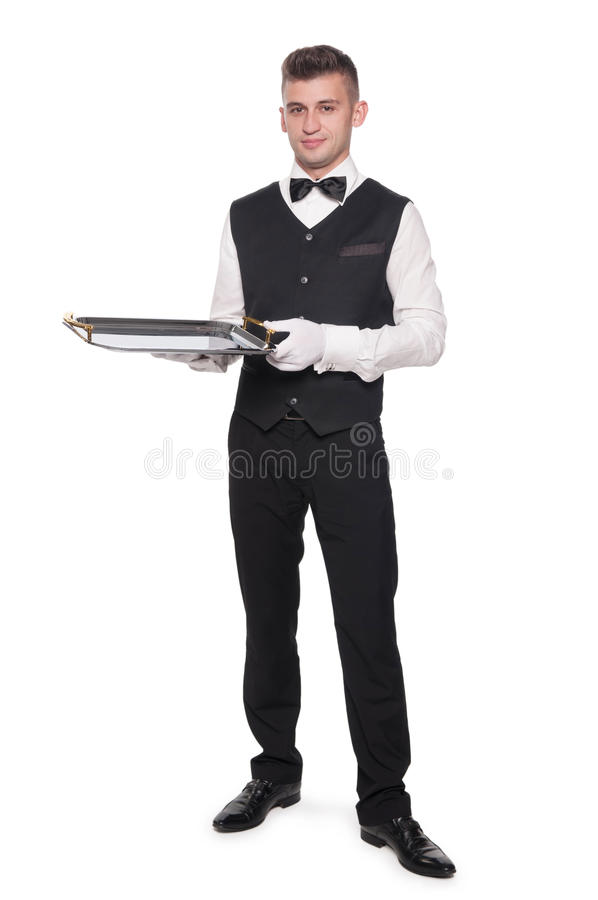A young boy waiter with a tray royalty free stock photography