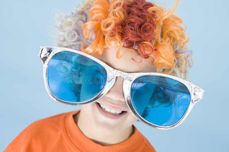 Download Young Boy Wearing Clown Wig And Sunglasses Smiling Stock Image - Image: 5946101