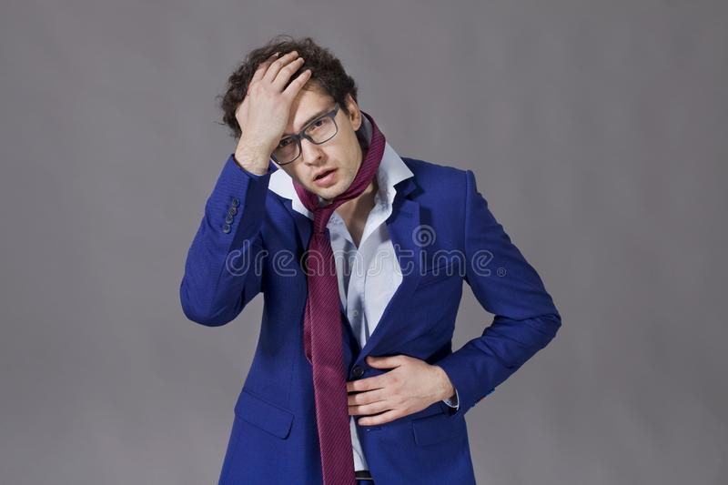 Guy wearing in suit and necktie feeling ill royalty free stock photo