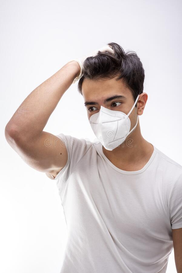 Young boy wearing surgical mask royalty free stock image