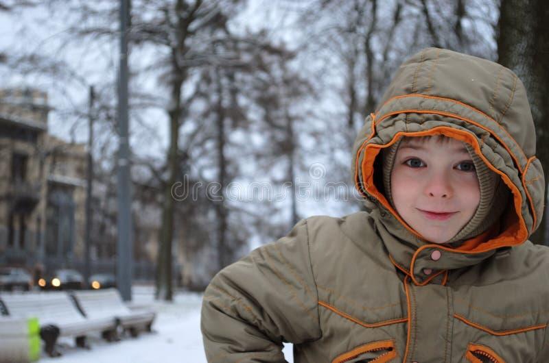 Young boy in winter city park stock photos
