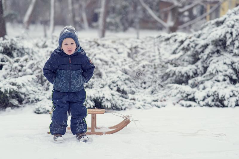 Young boy in the winter park. Young boy play in the winter park - Image royalty free stock photo