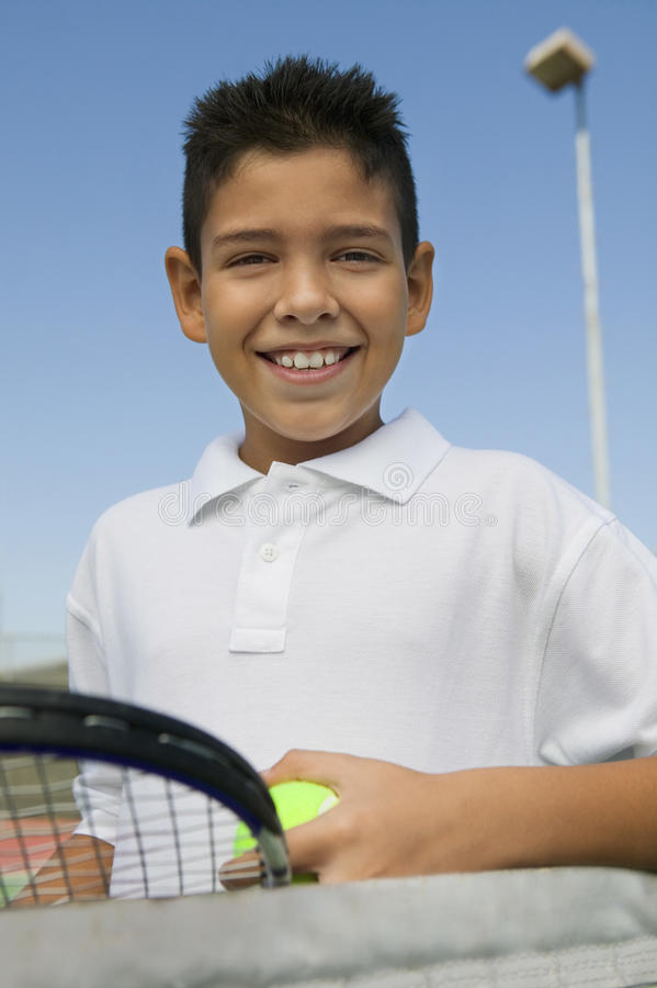 Free Young Boy With Tennis Racket And Ball At Net On Tennis Court Portrait Close Up Stock Photography - 30840102