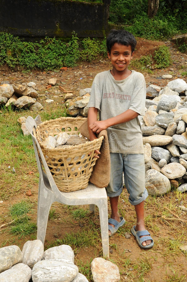 Young Boy works hard as porter, India stock image