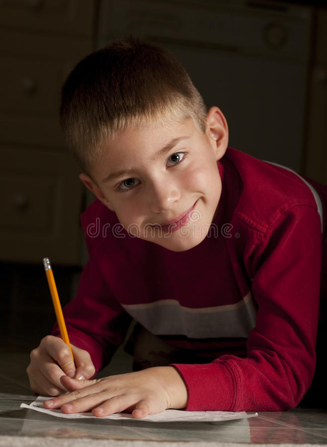 Download Young boy writing stock image. Image of smiling, male - 14147095