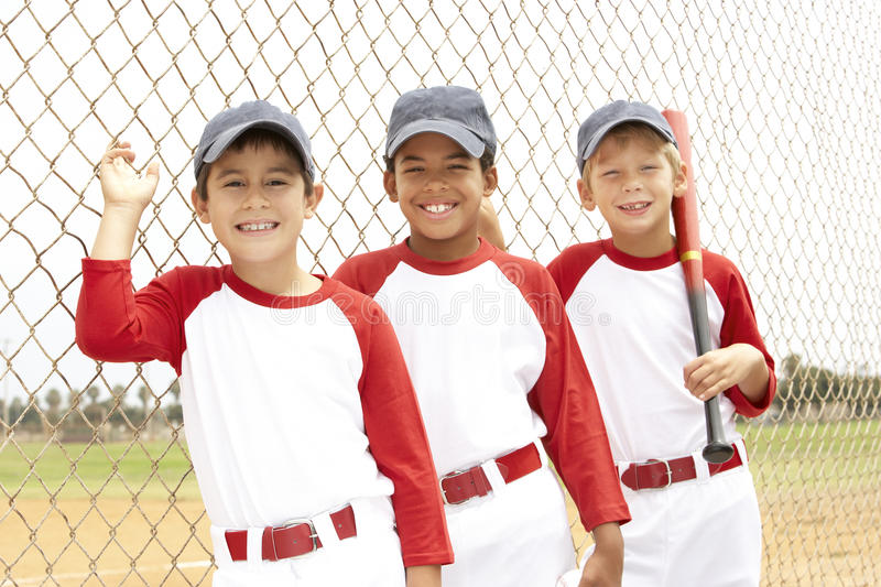 Young Boys In Baseball Team royalty free stock photos