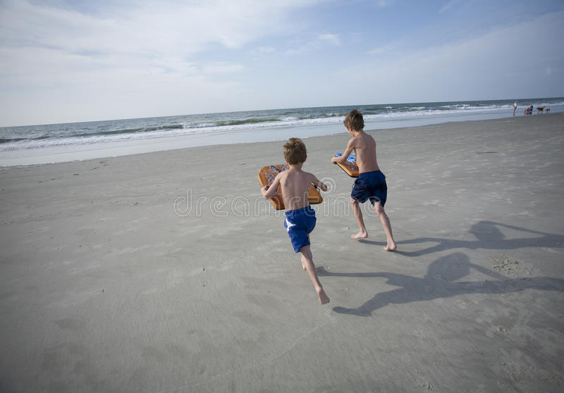 Download Young Boys at the Beach stock image. Image of blue, sport - 14829191
