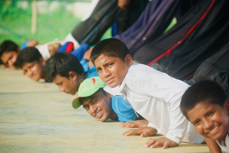 Young boys doing exercise in a group unique photo. Young boys doing exercise in a group isolated unique photo stock images