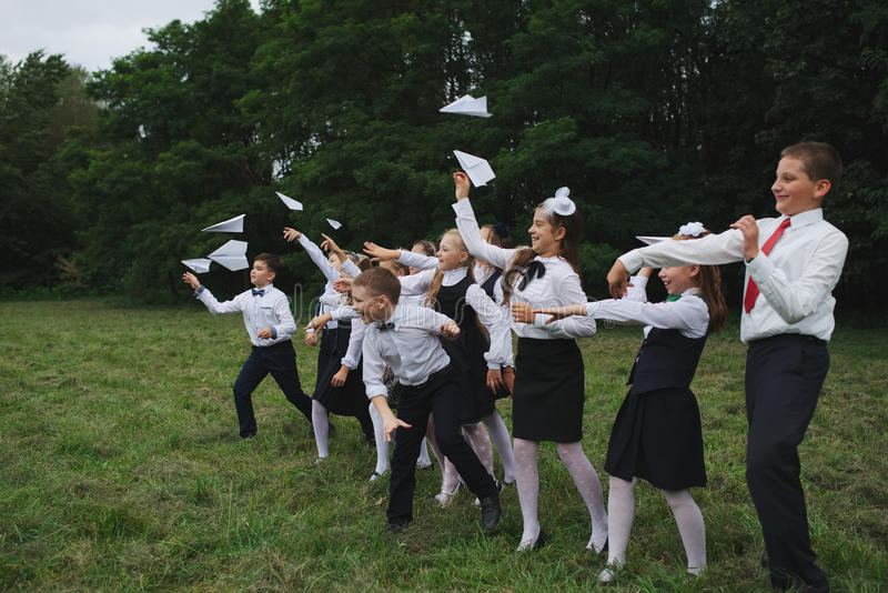 Young boys and girls in uniform outdoors stock photography