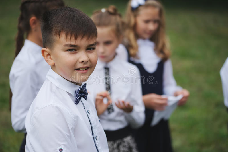 Young boys and girls in uniform outdoors royalty free stock image