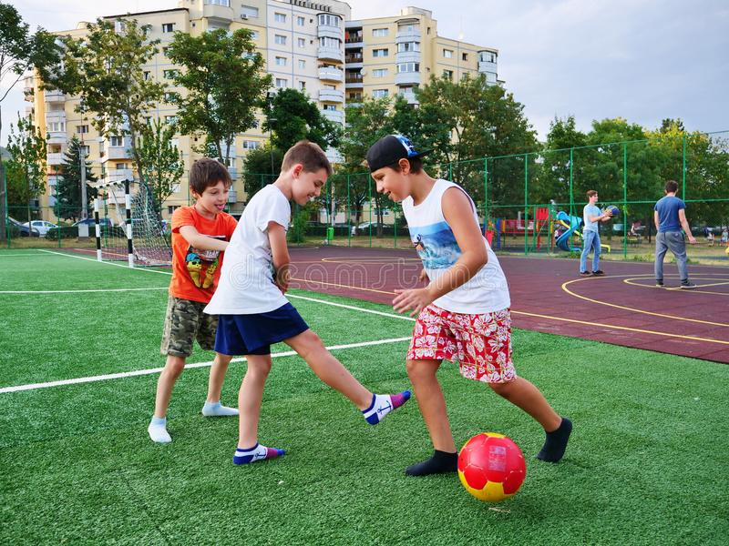 Young boys play football royalty free stock photo