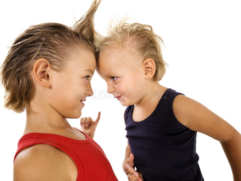 Young boys with punk hairstyle. Happy young boys with punk hairstyle royalty free stock photos