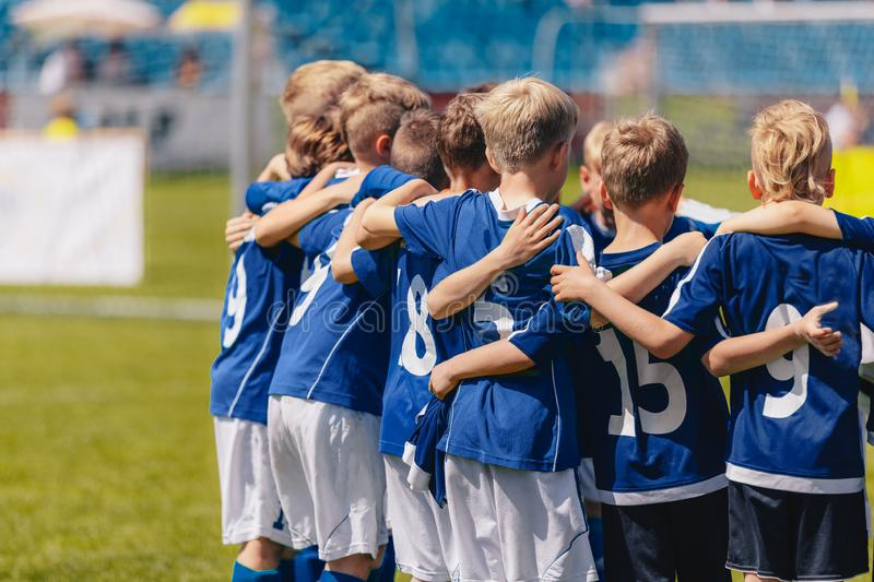 Young Boys of Sports Soccer Club Team Standing Together United. Kids Listening Coach Pre Match Speech royalty free stock images