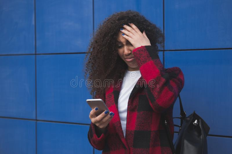 Young braided hair african american business girl using smartphone over isolated background annoyed and frustrated royalty free stock photo