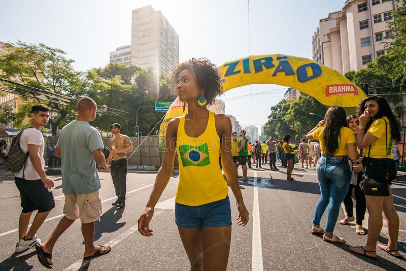 Young Brazilian Female Football Fan. Rio de Janeiro, Brazil - June 22, 2018: Young Brazilian woman is coming to support national football team during 2018 FIFA stock photos