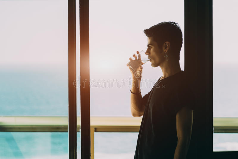Young brazilian guy drinking water royalty free stock photography