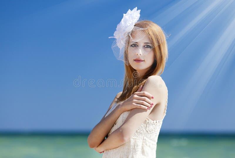 Young bride at the beach. Light stock photos