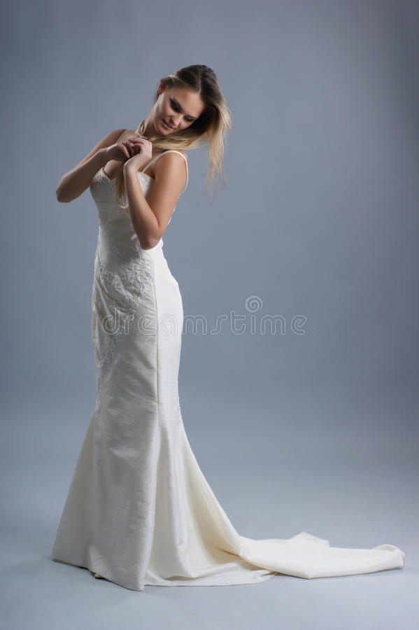 A young bride in a beautiful white wedding dress royalty free stock image