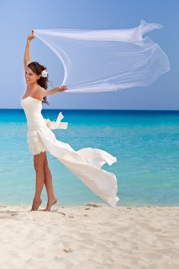Download Young bride and blue sea stock image. Image of white - 25341849