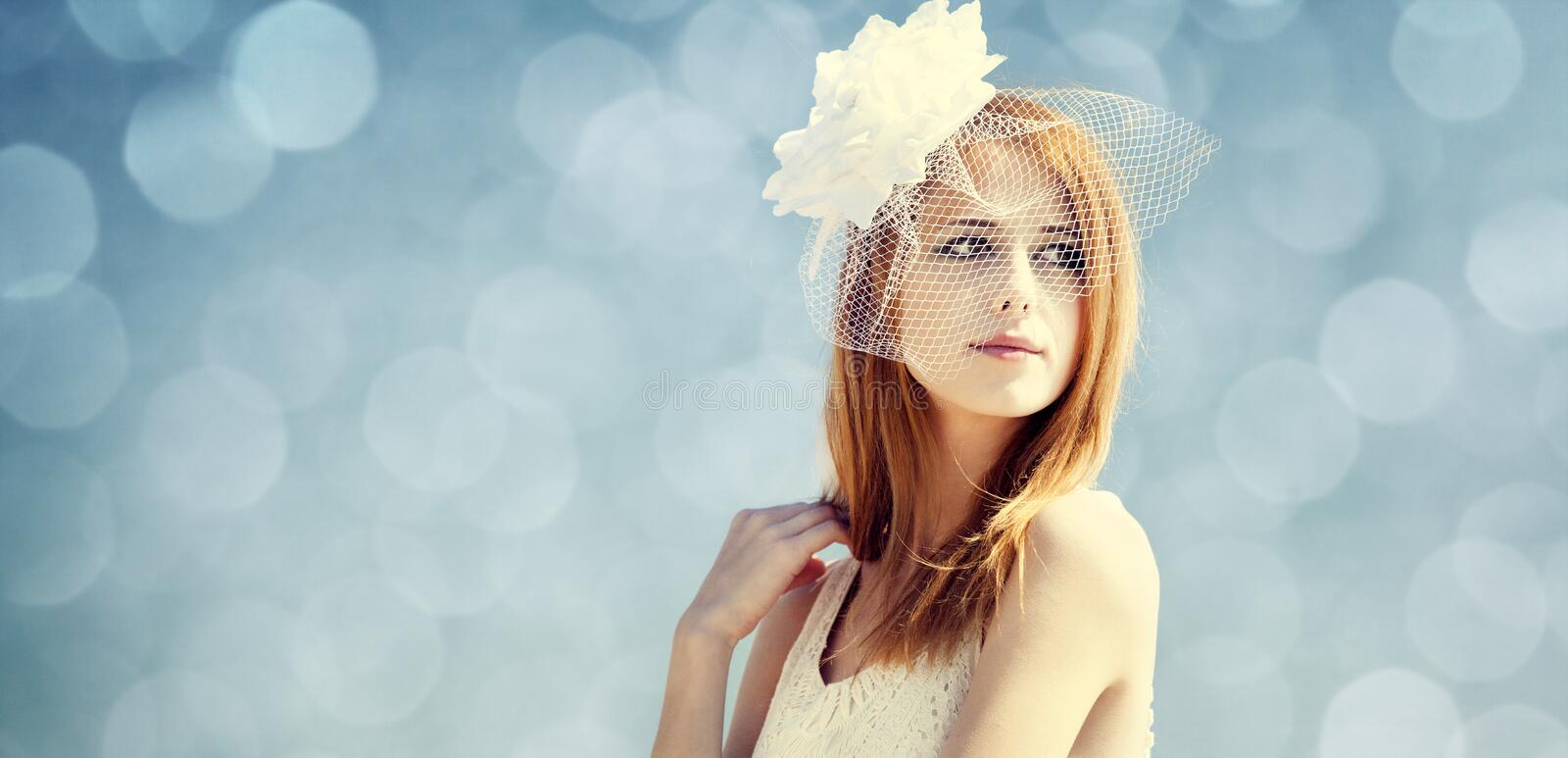 Young bride at blue sky background. Young bride at blue sky background royalty free stock photos