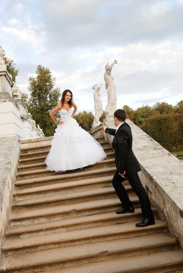 Young bride with bridegroom royalty free stock photos