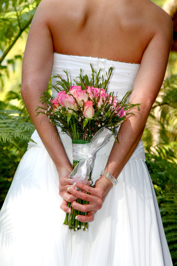 Young bride with flowerrs royalty free stock photography