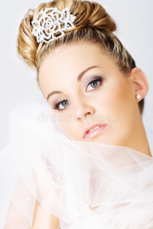 Young bride holding a veil royalty free stock images