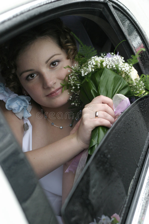 Download Young bride in a limousine stock photo. Image of eyes - 1990248