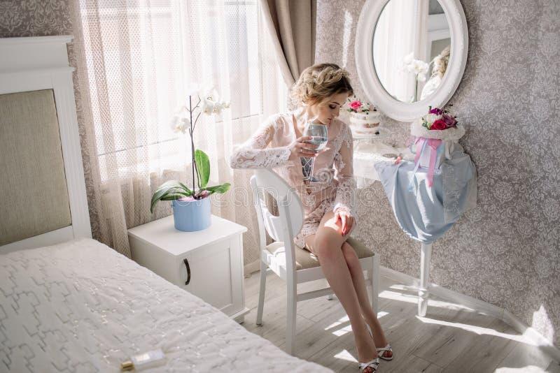 Young bride in a luxurious boudoir stock photos