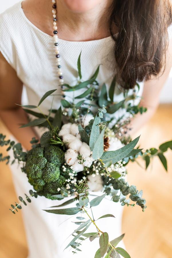 Young bride with modern foodie bouquet stock photography