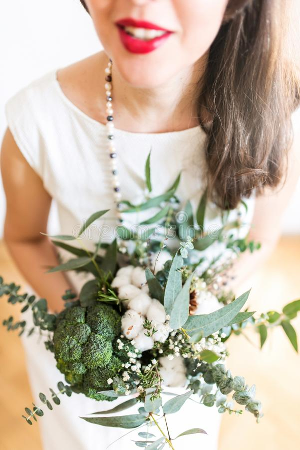 Young bride with modern foodie bouquet royalty free stock images