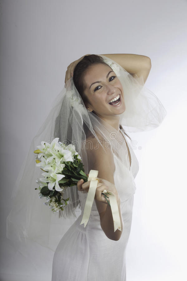 Download Young Bride In Veil With Bouquet Stock Image - Image: 27292783
