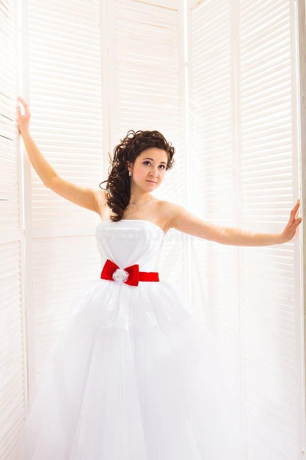Young bride in wedding dress, studio shot stock image