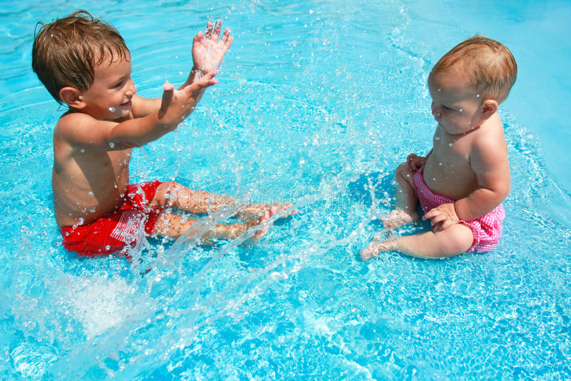 Download Young Brother And Sister Playing In Pool Stock Photo - Image: 11042388