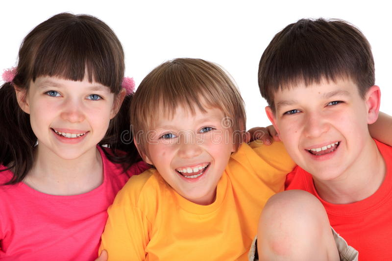 Young brothers and sister. Two Caucasian young boys and a girl, siblings royalty free stock photos