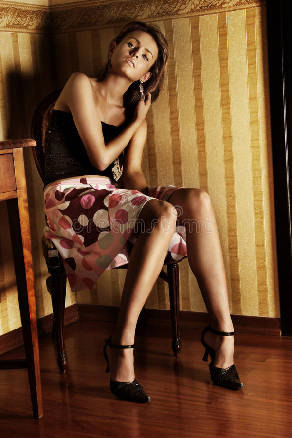 Download Young brunette stock photo. Image of hands, fashion, interior - 9417982