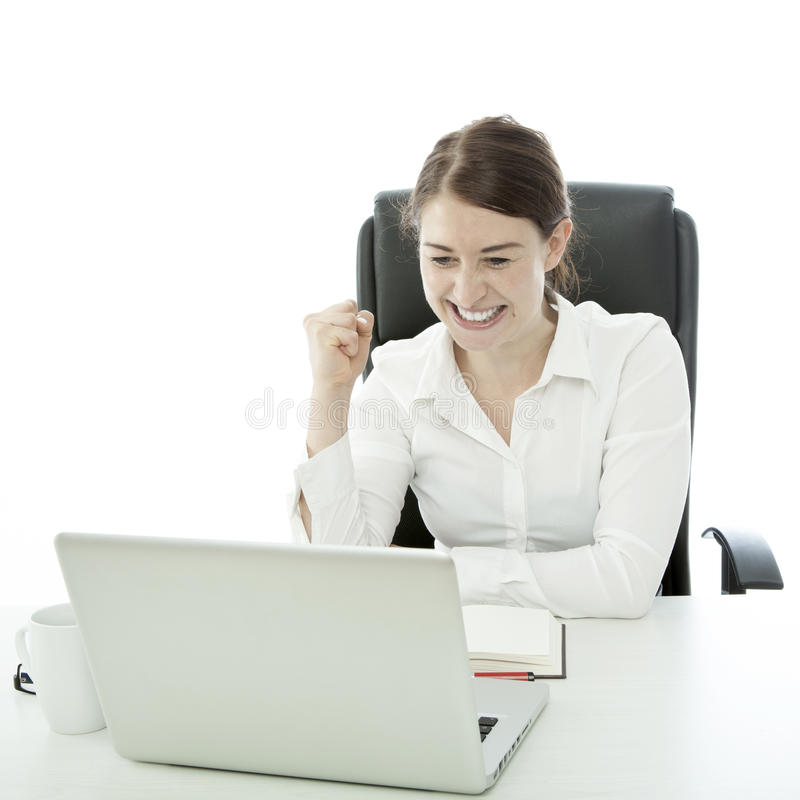 Young brunette business woman is happy. Behind laptop stock image