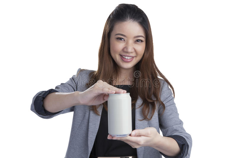 Young brunette businesswoman presenting a can of soft drink. Isolated on white background stock photography