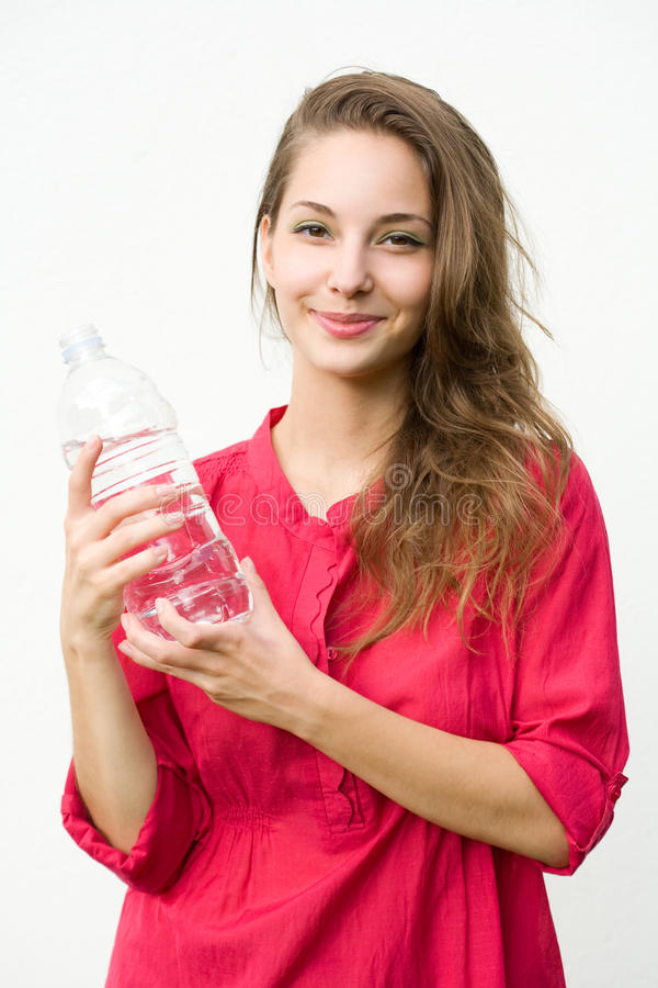 Download Young Brunette With Cool Refreshment. Stock Image - Image: 26154871