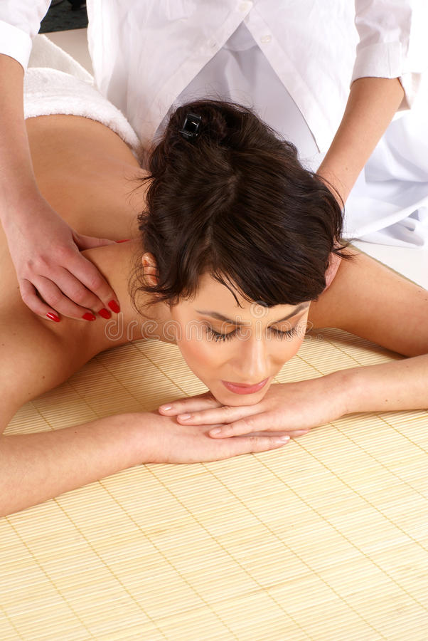 Download A Young Brunette Is Getting Spa Treatment Stock Image - Image: 13967933