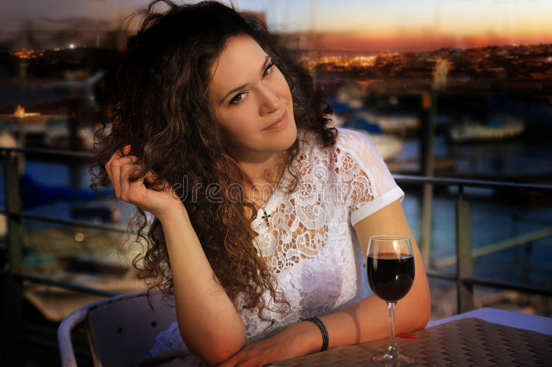 Young brunette girl with a glass of wine stock photos