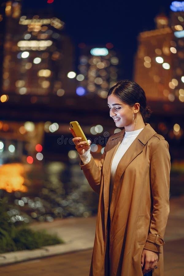 Girl at night with phone stock photos