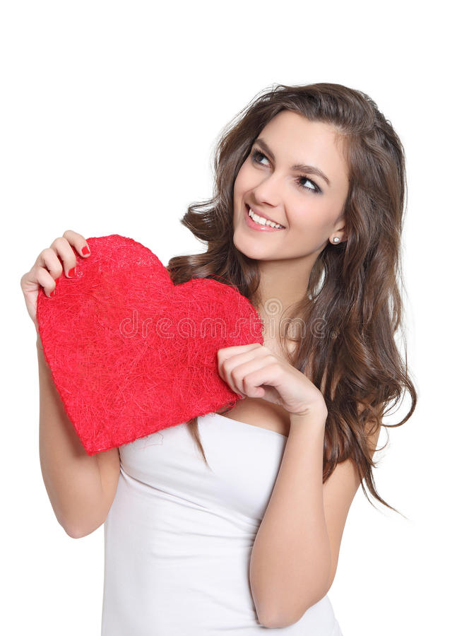 Young brunette holding a big love sign stock images