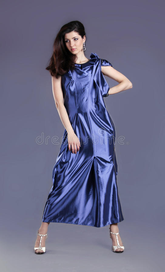 Download Young Brunette Lady In Blue Dress Posing Stock Photo - Image: 25065440
