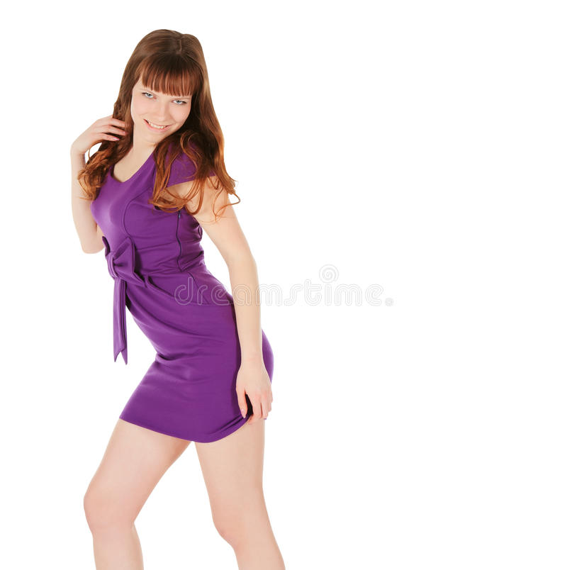 Young brunette in magentas dress posing over royalty free stock images