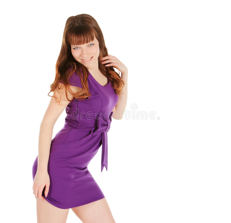 Young brunette in magentas dress posing over white royalty free stock image