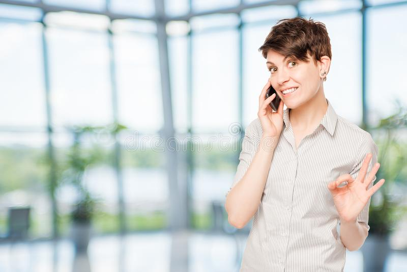 Young brunette with a phone stock image