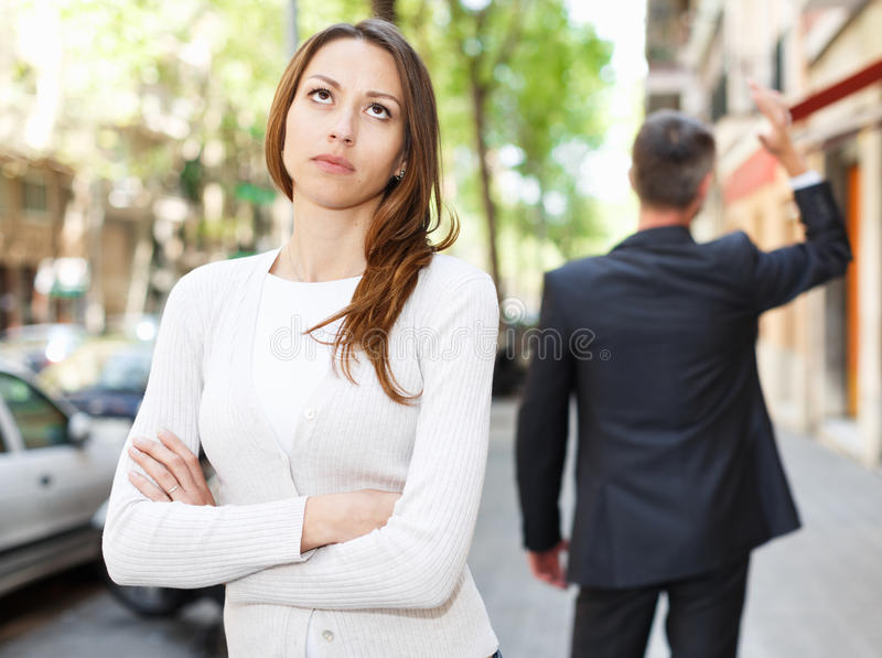 Young brunette in quarrel with boyfriend royalty free stock photos